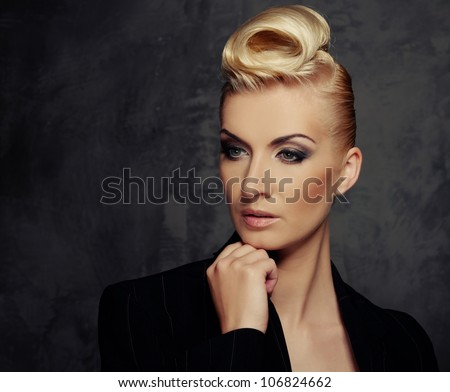 Fashionable woman with creative hairstyle - stock photo