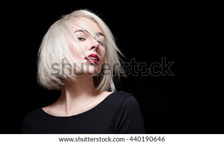Fashionable woman with red lipstick and short hair on black background - stock photo