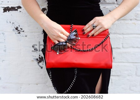 Fashionable woman with  stylish red clutch , accessories, sunglasses white background - stock photo