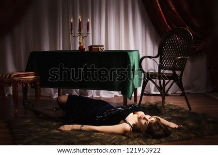 Fashionable women lying on a table in a luxury boudoir - stock photo
