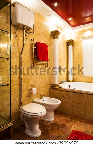 Fashionable yellow bathroom in a modern apartment - stock photo