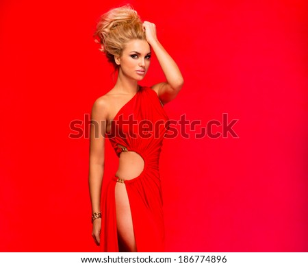 Fashionable young beautiful blonde woman posing in red elegant dress. Sexy look. - stock photo