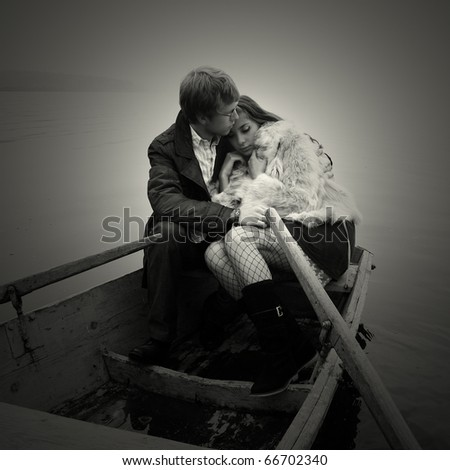Fashionable young couple in love - stock photo