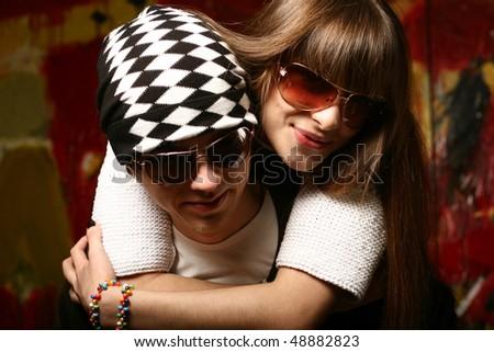 Fashionable young couple wearing sunglasses - stock photo