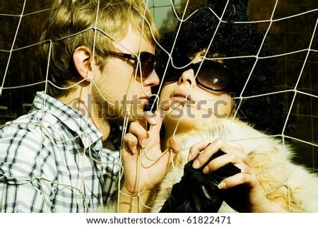 Fashionable young couple wearing sunglasses. Art photo - stock photo