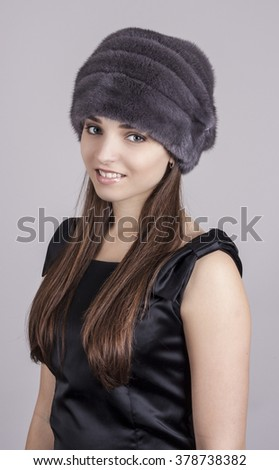 Fashionable young girl in a hat. Hat made of natural mink. - stock photo