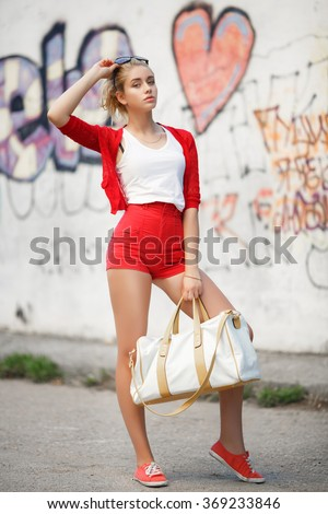 Fashionable young girl outdoor portrait, fashion girl hipster at city street, glamour model vogue style, elegant young woman in casual clothes, trendy soft grain instagram filter like, series - stock photo