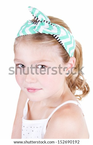 Fashionable young girl wearing vintage fabric headband, isolated on white