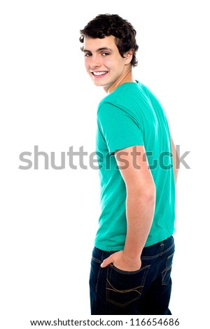 Fashionable young guy turning back and looking at you - stock photo
