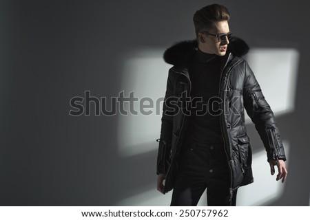 Fashionable young man posing - stock photo