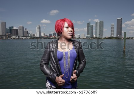 Fashionable young woman by the marina - stock photo