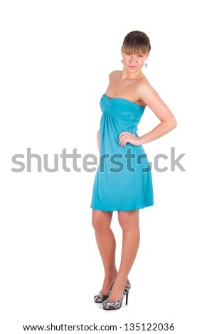 Fashionable young woman in beautiful blue dress posing at studio. Isolated over white.