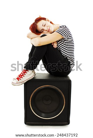 Fashionable young woman on the speaker, music fashion party. Isolated on white background - stock photo