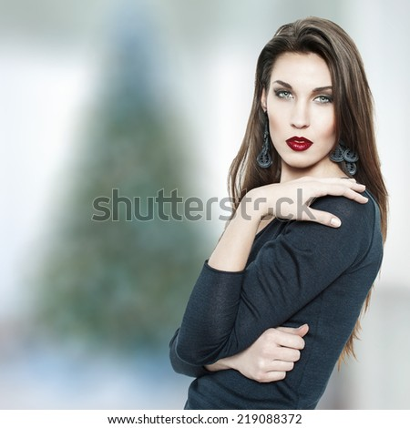 Fashionable young woman with red lips posing, christmas - stock photo