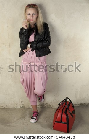 Fashioned woman on a vintage background - stock photo
