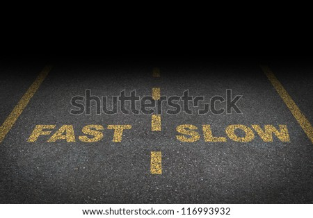 Fast and slow lanes as a business dilemma on how to proceed with a financial plan and strategy for growing conservative or aggressive growth as an asphalt road with yellow painted dividing lines. - stock photo