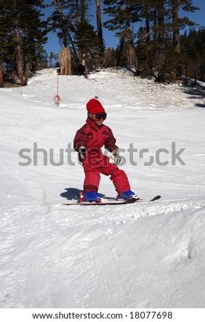 fast beginner kid on ski - stock photo