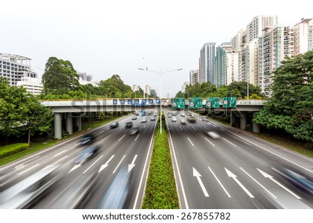 Fast blurry car on highway - stock photo