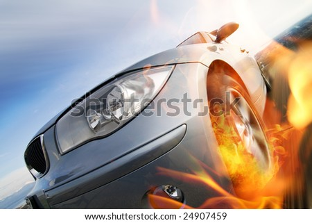 Fast car moving with motion blur with fire burning tires - stock photo