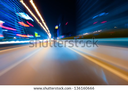Fast car through city - stock photo