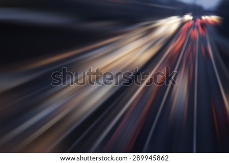 fast cars on highway in evening - stock photo