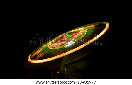 Fast circular ride at the state fair. - stock photo