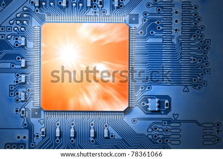 Fast CPU / Processor with orange sun and cloud graphic, representing power, speed and efficiency, on blue computer, electronic circuit board - stock photo