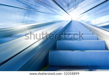 Fast escalator move in office centre - stock photo