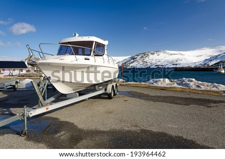 Fast fishing boat on a trailer - stock photo