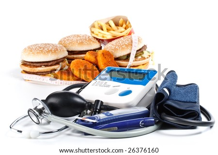 Fast-food, blood pressure meter, stethoscope and glucose meter on a white background - stock photo