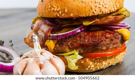 fast food. burger on a wooden table