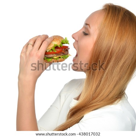 Fast food concept. Tasty unhealthy burger sandwich in hands hungry mouth getting ready to eat isolated on a white background - stock photo