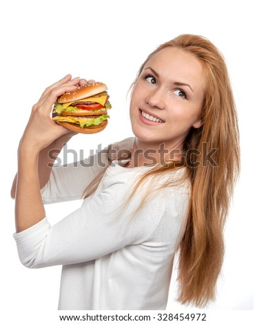 Fast food concept. Tasty unhealthy burger sandwich in hands hungry woman getting ready to eat isolated on a white background - stock photo