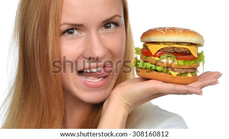 Fast food eating concept Woman hold cheeseburger sandwich with cheese salad tomatoes beef in hands hungry getting ready to eat isolated on a white background  - stock photo