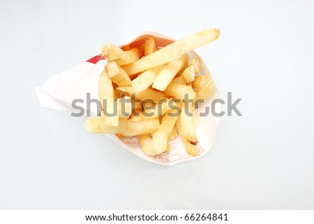 Fast food french fries on white background.
