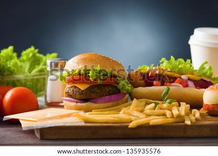 fast food group  photo of  hot dog,  burger, french fries, tomato drinks and many more - stock photo