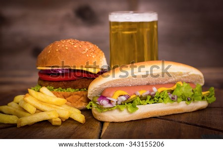 Fast food - Hot dog, hamburger and French fries  - stock photo