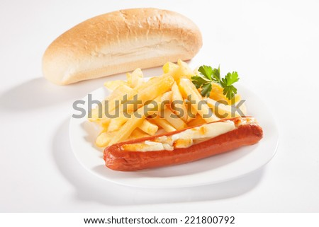 Fast food menu - sausage and french fries in a plate - stock photo