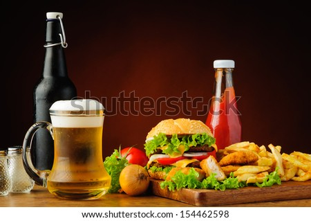 fast food menu with hamburger, chicken nuggets, french fries and beer