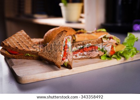 Fast food plate with burger hot dog sandwiches and chicken wrap - stock photo