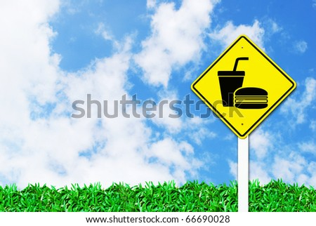 fast food sign on beautiful sky and grass field background - stock photo