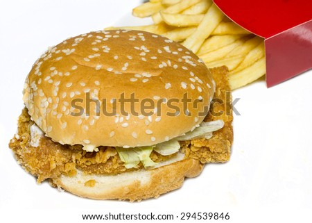 Fast food tasty chicken burger with fried potatoes. - stock photo