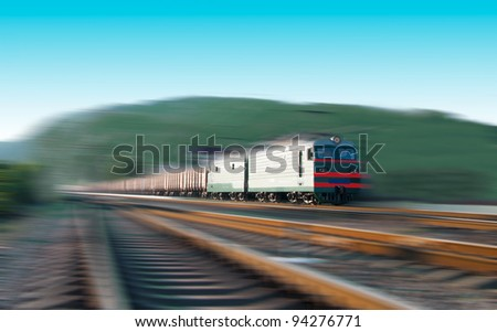 Fast freight train with motion blur - stock photo