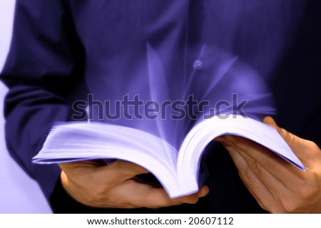 Fast learning concept: businessman reading a book - stock photo