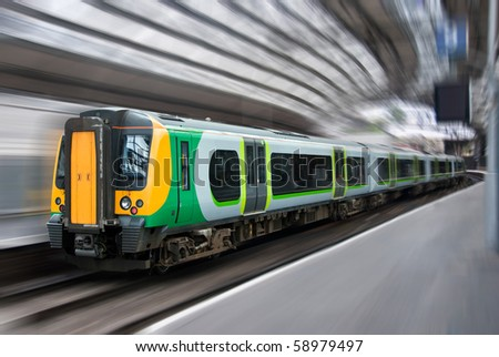 Fast Modern Passenger Speed Commuter Train Side in the Station with Motion Radial Zoom Blur - stock photo