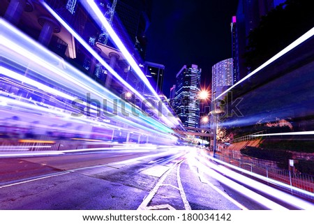 Fast moving car light in Hong Kong - stock photo