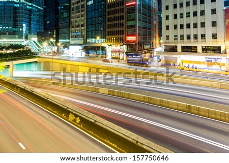 Fast moving cars at night