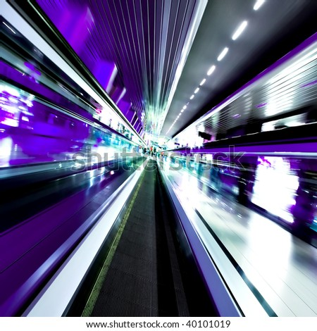 fast moving escalator in motion - stock photo