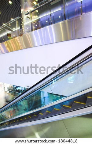 Fast moving escalator in shopping center