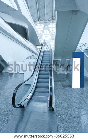 fast moving escalator inside shopping mall